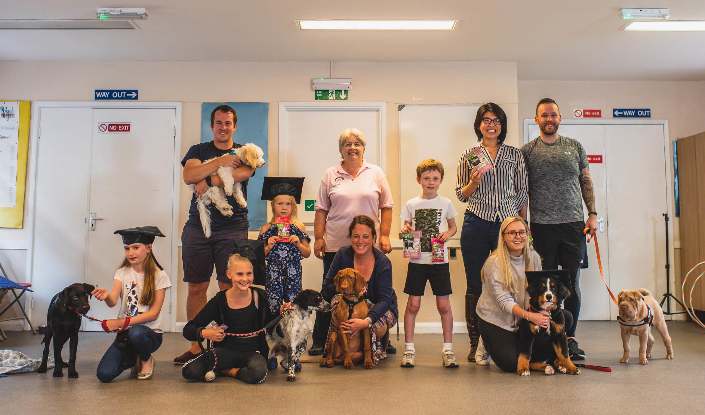 Puppy School graduation owners and puppies with trainer